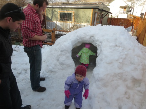 Lucy and Josie explore their play igloo